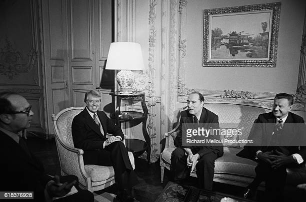 United States President Jimmy Carter and his national security advisor Zbigniew Brzezinski meet with Parti Socialiste leader Francois Mitterrand at...