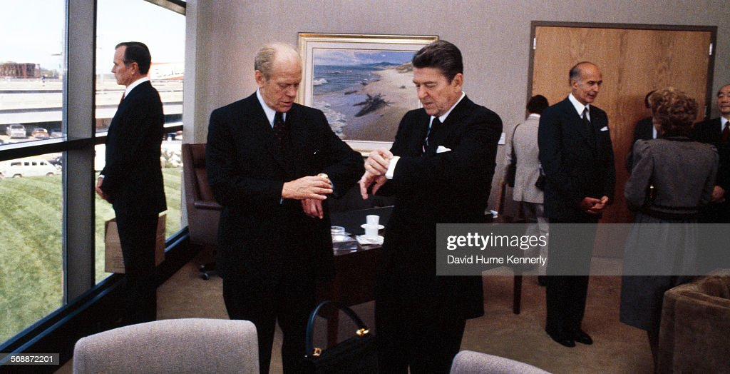 United States President <a gi-track='captionPersonalityLinkClicked' href=/galleries/search?phrase=Ronald+Reagan+-+US+President&family=editorial&specificpeople=69998 ng-click='$event.stopPropagation()'>Ronald Reagan</a> and former President <a gi-track='captionPersonalityLinkClicked' href=/galleries/search?phrase=Gerald+Ford&family=editorial&specificpeople=125222 ng-click='$event.stopPropagation()'>Gerald Ford</a> check their watches at the Dedication of the Gerald R. Ford Presidential Museum September, 18, 1981 in Grand Rapids, Michigan. Former French President Giscard d'Estaing (right, back) and Vice President George H.W. Bush (left, looking out window) also attend.