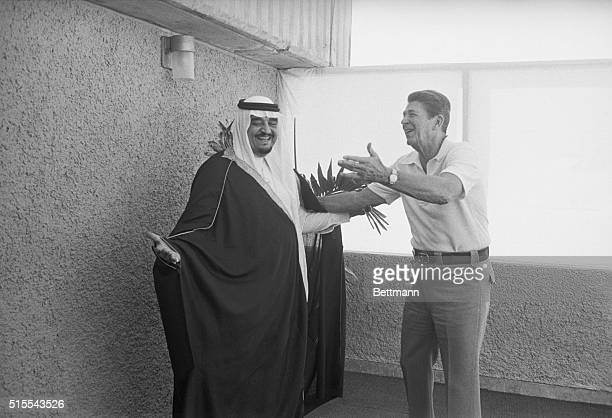 United States President Ronald Reagan gesturing to Saudi Arabian Crown Prince and Prime Minister Faud bin Abdul Aziz before the International Meeting...