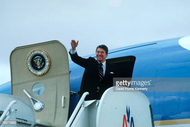 United States President Ronald Reagan waves as he departs on Air Force One in 1983 in Los Angeles CA