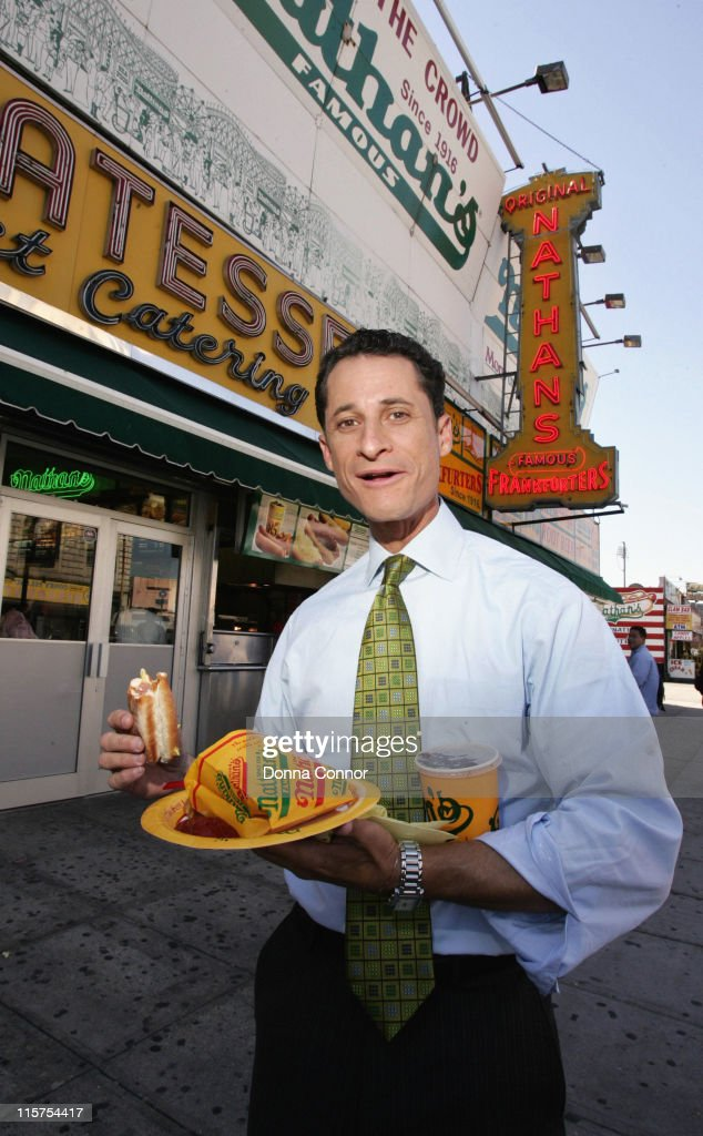 United States Representative for New York <a gi-track='captionPersonalityLinkClicked' href=/galleries/search?phrase=Anthony+Weiner&family=editorial&specificpeople=821661 ng-click='$event.stopPropagation()'>Anthony Weiner</a> poses at a hot dog stand in Coney Island on September 21, 2004 in Brooklyn, New York.