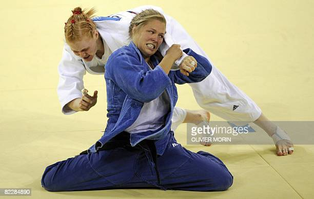 United States Ronda Rousey and Germany's Annett Boehm compete in their women's 70kg judo bronze medal match of the 2008 Beijing Olympic Games on...