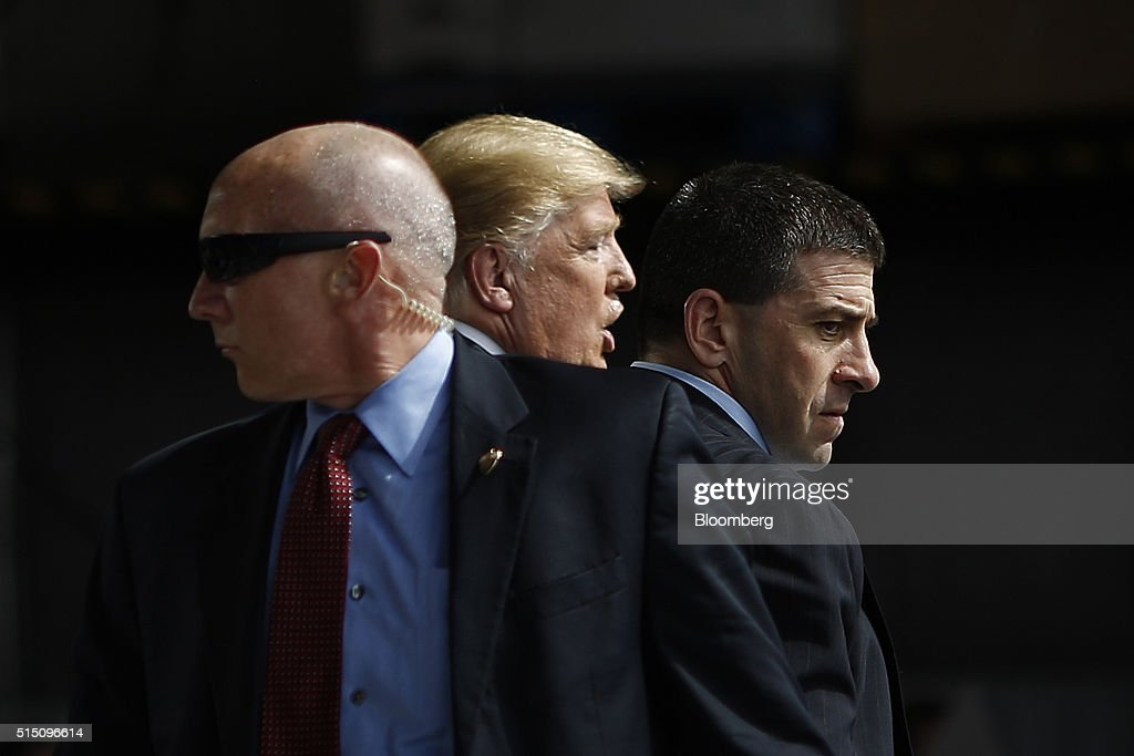 United States Secret Service Agents surround Donald Trump president and chief executive of Trump Organization Inc and 2016 Republican presidential...