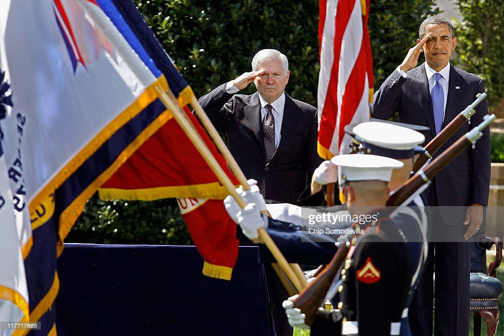 United States Secretary of Defense Robert Gates (L) and President <a gi-track='captionPersonalityLinkClicked' href=/galleries/search?phrase=Barack+Obama&family=editorial&specificpeople=203260 ng-click='$event.stopPropagation()'>Barack Obama</a> salute during the presentation of the colors during Armed Forces Farewell Tribute on the River Parade Field at the Pentagon June 30, 2011 in Arlington, Virginia. Appointed by former President George W. Bush in 2006, Gates is credited with many landmark decisions and actions, including the turning around of the war in Iraq by directing the troop surge, the repeal of the don't ask, don't tell policy, the handling of the Walter Reed Army Medical Center neglect scandal and a huge shift toward fiscal restraint in military spending. Gates will be succeeded as head of the Pentagon by CIA Director Leon Panetta.