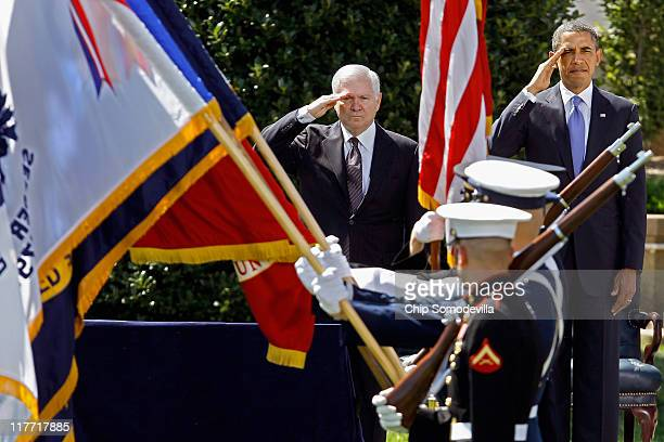 United States Secretary of Defense Robert Gates and President Barack Obama salute during the presentation of the colors during Armed Forces Farewell...