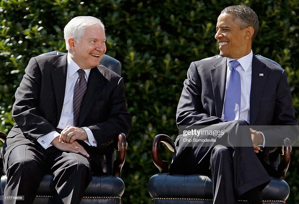 United States Secretary of Defense Robert Gates (L) and President <a gi-track='captionPersonalityLinkClicked' href=/galleries/search?phrase=Barack+Obama&family=editorial&specificpeople=203260 ng-click='$event.stopPropagation()'>Barack Obama</a> share a laugh during Gates' Armed Forces Farewell Tribute on the River Parade Field at the Pentagon June 30, 2011 in Arlington, Virginia. Appointed by former President George W. Bush in 2006, Gates is credited with many landmark decisions and actions, including the turning around of the war in Iraq by directing the troop surge, the repeal of the don't ask, don't tell policy, the handling of the Walter Reed Army Medical Center neglect scandal and a huge shift toward fiscal restraint in military spending. Gates will be succeeded as head of the Pentagon by CIA Director Leon Panetta.