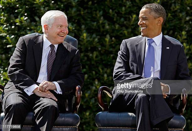 United States Secretary of Defense Robert Gates and President Barack Obama share a laugh during Gates' Armed Forces Farewell Tribute on the River...