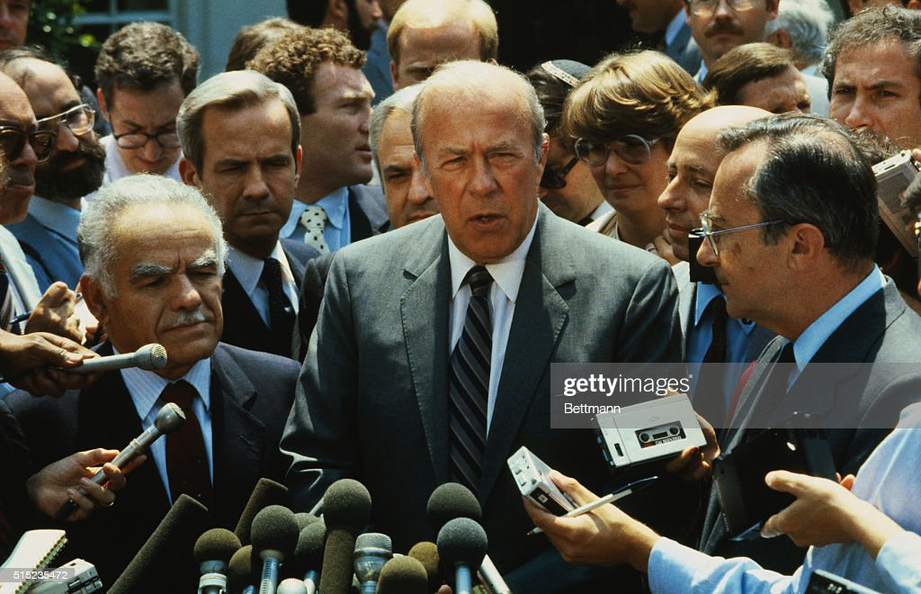 United States Secretary of State George Shultz (C), Israeli Foreign Minister Yitzak Shamir, (L), and Israeli Ambassador to the US Moshe Arens (R) talk with reporters.