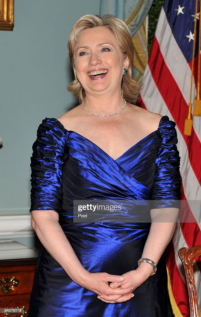 United States Secretary of State Hillary Rodham Clinton enjoys a laugh as the 2009 Kennedy Center honorees assemble for the formal group photo with...
