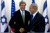 United States Secretary of State John Kerry and Israeli Prime Minister Benjamin Netanyahu shake hands at the conclusion of their statements after...