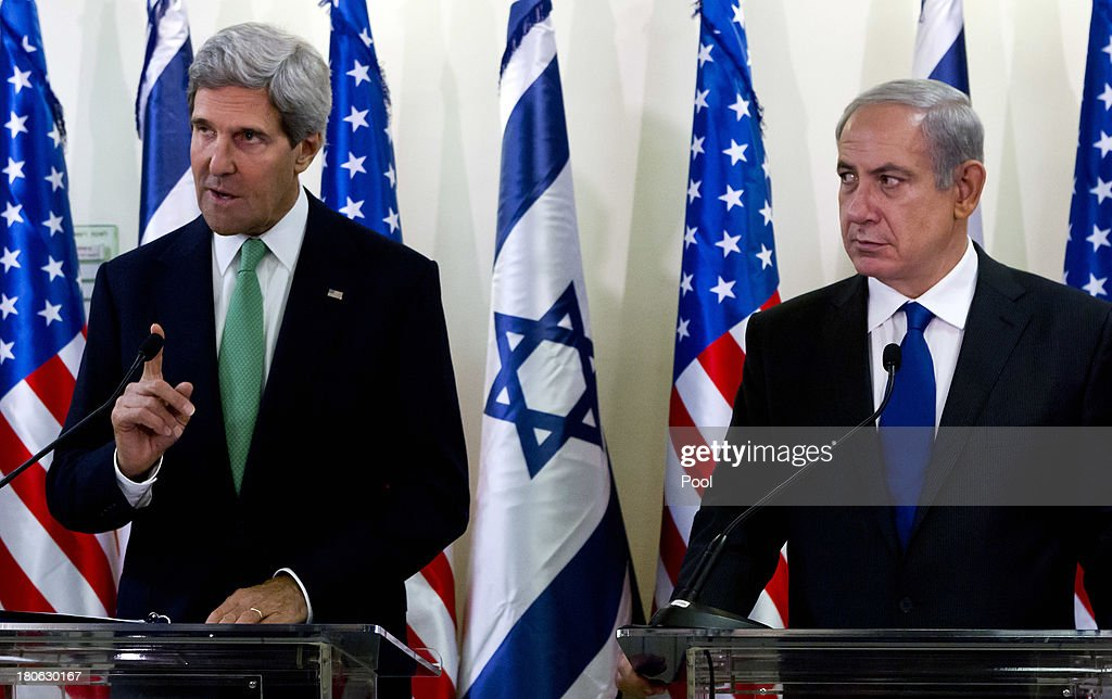 United States Secretary of State John Kerry (L) and Israeli Prime Minister Benjamin Netanyahu give a press statement after their lengthly meeting in the prime minister's Jerusalem offices, September 15, 2013 in Jerusalem, Israel. The two discussed the need to remove all of Syria's chemical weapons, and the need to progress with the Middle East peace process with the Palestinians, something Kerry said he would do without talking about it until the end of the process. Most of the statements by both leaders dealt with Syria and their use of chemical weapons.