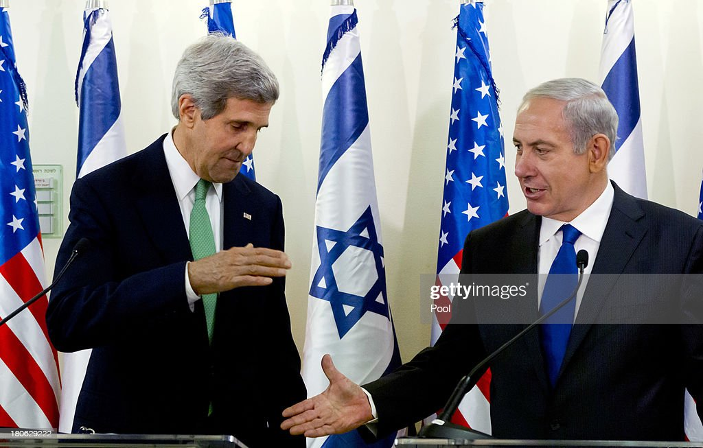 United States Secretary of State <a gi-track='captionPersonalityLinkClicked' href=/galleries/search?phrase=John+Kerry&family=editorial&specificpeople=154885 ng-click='$event.stopPropagation()'>John Kerry</a> (L) and Israeli Prime Minister <a gi-track='captionPersonalityLinkClicked' href=/galleries/search?phrase=Benjamin+Netanyahu&family=editorial&specificpeople=118594 ng-click='$event.stopPropagation()'>Benjamin Netanyahu</a> go to shake hands at the conclusion of their statements after their lengthly meeting in the prime minister's Jerusalem offices, September 15, 2013 in Jerusalem, Israel. The two discussed the need to remove all of Syria's chemical weapons, and the need to progress with the Middle East peace process with the Palestinians, something Kerry said he would do without talking about it until the end of the process. Most of the statements by both leaders dealt with Syria and their use of chemical weapons.