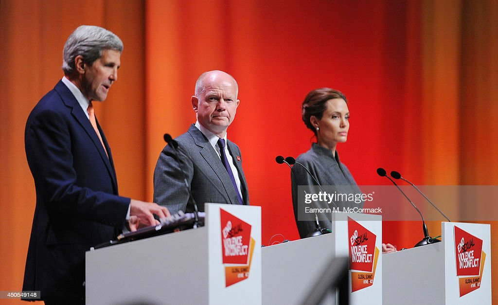 United States Secretary of State <a gi-track='captionPersonalityLinkClicked' href=/galleries/search?phrase=John+Kerry&family=editorial&specificpeople=154885 ng-click='$event.stopPropagation()'>John Kerry</a>, British Foreign Secretary <a gi-track='captionPersonalityLinkClicked' href=/galleries/search?phrase=William+Hague&family=editorial&specificpeople=206295 ng-click='$event.stopPropagation()'>William Hague</a>, UN Special Envoy and actress <a gi-track='captionPersonalityLinkClicked' href=/galleries/search?phrase=Angelina+Jolie&family=editorial&specificpeople=201591 ng-click='$event.stopPropagation()'>Angelina Jolie</a> attend the Global Summit to End Sexual Violence in Conflict at ExCel on June 13, 2014 in London, England. The four-day conference on sexual violence in war is hosted by Foreign Secretary <a gi-track='captionPersonalityLinkClicked' href=/galleries/search?phrase=William+Hague&family=editorial&specificpeople=206295 ng-click='$event.stopPropagation()'>William Hague</a> and UN Special Envoy and actress <a gi-track='captionPersonalityLinkClicked' href=/galleries/search?phrase=Angelina+Jolie&family=editorial&specificpeople=201591 ng-click='$event.stopPropagation()'>Angelina Jolie</a>.
