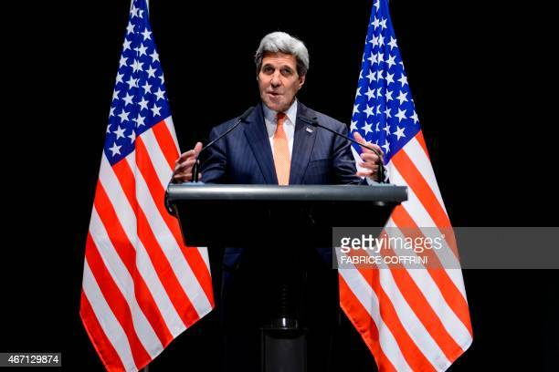 United States Secretary of State John Kerry gestures as he delivers a statement about the recently concluded round of negotiations with Iran over...