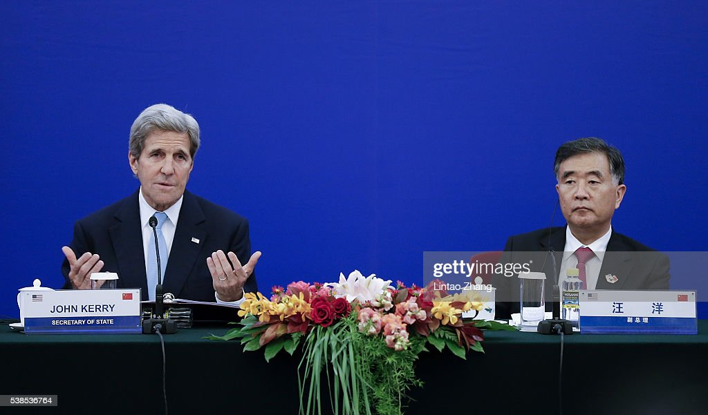 United States Secretary of State <a gi-track='captionPersonalityLinkClicked' href=/galleries/search?phrase=John+Kerry&family=editorial&specificpeople=154885 ng-click='$event.stopPropagation()'>John Kerry</a> (L) launches a speech with Chinese Vice Premier <a gi-track='captionPersonalityLinkClicked' href=/galleries/search?phrase=Wang+Yang+-+Politician&family=editorial&specificpeople=9984662 ng-click='$event.stopPropagation()'>Wang Yang</a> (R) during the closing ceremony of the eighth round of US-China Strategic and Economic Dialogue at the Great Hall of the People on June 6, 2016 in Beijing, China. Kerry has been in China for talks on a variety of issues including seeking diplomatic solutions for the South China Sea.
