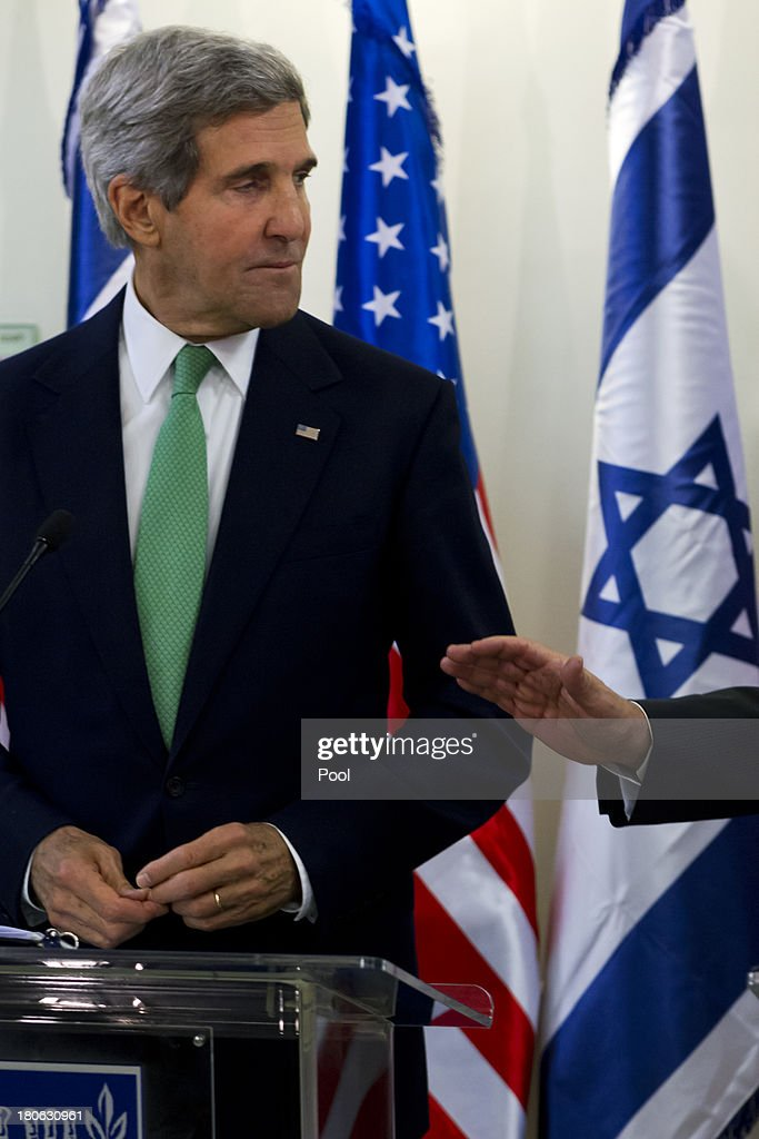 United States Secretary of State <a gi-track='captionPersonalityLinkClicked' href=/galleries/search?phrase=John+Kerry&family=editorial&specificpeople=154885 ng-click='$event.stopPropagation()'>John Kerry</a> listens during a press statement with Israeli Prime Minister Benjamin Netanyahu after their lengthly meeting in the prime minister's Jerusalem offices, September 15, 2013 in Jerusalem, Israel. The two discussed the need to remove all of Syria's chemical weapons, and the need to progress with the Middle East peace process with the Palestinians, something Kerry said he would do without talking about it until the end of the process. Most of the statements by both leaders dealt with Syria and their use of chemical weapons.