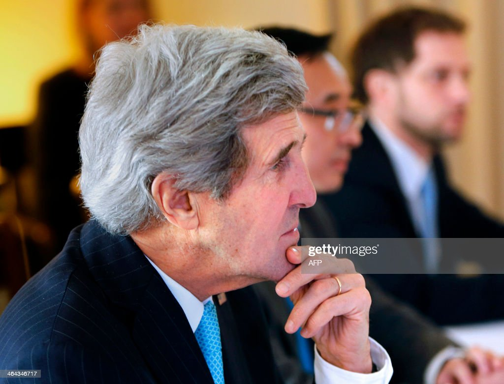 United States Secretary of State John Kerry meets with Chinese Foreign Minister (not pictured) prior to peace talks in Montreux on January 22, 2014. Representatives of Syrian President Bashar al-Assad, a deeply divided opposition, world powers and regional bodies started a long-delayed peace conference aimed at bringing an end to a nearly three-year civil war.