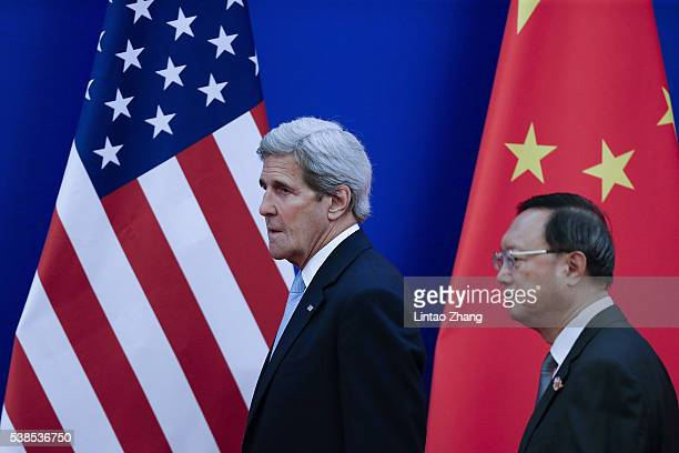 United States Secretary of State John Kerry with Chinese State Councilor Yang Jiechi arrive to the closing ceremony of the eighth round of USChina...