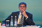 United States Secretary of the Treasury Jacob Lew at right attends a panel for the Highlevel Tax Symposium held in Chengdu in Southwestern China's...