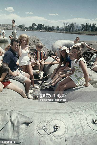 United States Senator from Massachusetts Ted Kennedy sits in a raft with his wife Joan Bennett Kennedy and Ethel Kennedy along with various other...