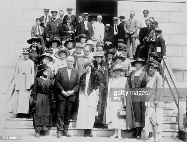 United States Senator from Ohio Warren G Harding with a delegation of women's rights activists from the The National Woman's Party shortly after he...