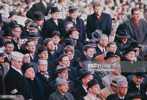 United States Senators Robert F Kennedy and Edward 'Ted' Kennedy pictured in centre of audience members and guests at the second inauguration...