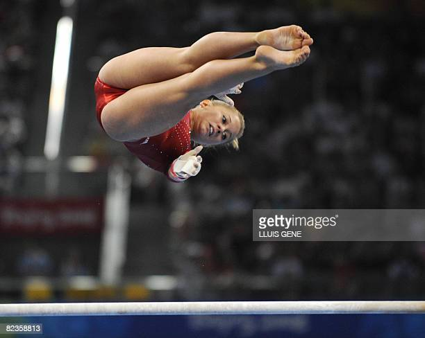 United States' Shawn Johnson competes on the uneven bars during the women's individual allaround final of the artistic gymnastics event of the...