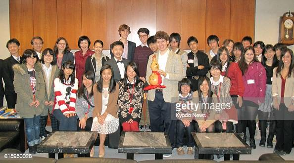 NEW YORK United States Students from Itami High School in Japan and Baruch College Campus High School in the United States pose for a photo session...