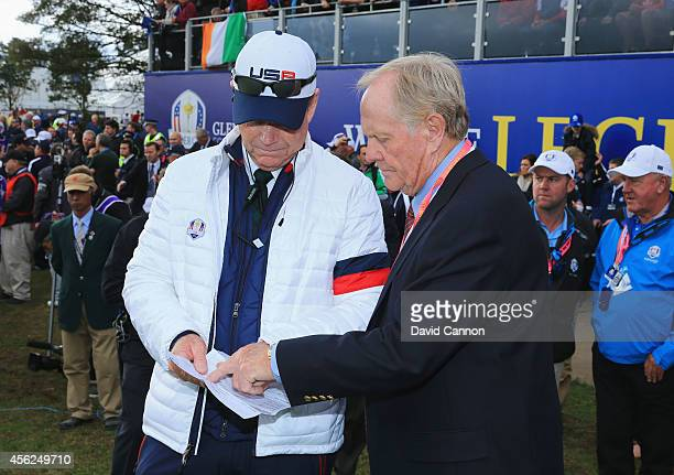 United States team captain Tom Watson talks with Jack Nicklaus on the 1st tee during the Singles Matches of the 2014 Ryder Cup on the PGA Centenary...