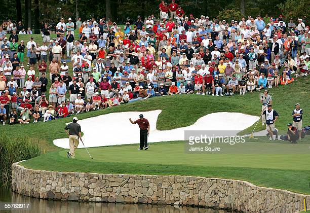 United States team member Fred Funk celbrates after sinking a putt on the 12th hole during Saturday Foursomes matches at the 2005 Presidents Cup on...