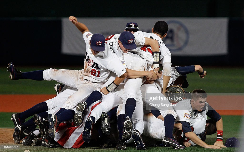 United States team players celebrate after winning the U18 Baseball World Championship final match between USA and Canada at Mokdong stadium on September 8, 2012 in Seoul, South Korea.