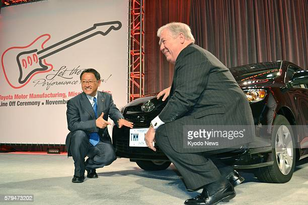 SPRINGS United States Toyota Motor Corp President Akio Toyoda and Mississippi Gov Haley Barbour pose in front of the first Corolla produced at the...