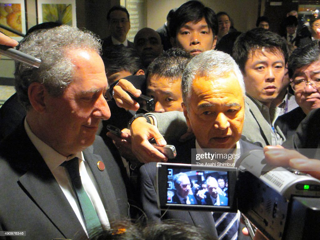 United States Trade Representative <a gi-track='captionPersonalityLinkClicked' href=/galleries/search?phrase=Michael+Froman&family=editorial&specificpeople=5935975 ng-click='$event.stopPropagation()'>Michael Froman</a> and Japanese Minister for the Trans Pacific Partnership <a gi-track='captionPersonalityLinkClicked' href=/galleries/search?phrase=Akira+Amari&family=editorial&specificpeople=3868034 ng-click='$event.stopPropagation()'>Akira Amari</a> speaks to media reporters after a TPP ministrial meeting on October 1, 2015 in Atlanta, Georgia. The TPP negotiation was extended a day for further talks eyeing to reach agreements.