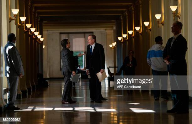 United States Trade Representative Robert Lighthizer and Mexican Secretary of Economy Ildefonso Guajardo Villarreal wait for the start of a press...