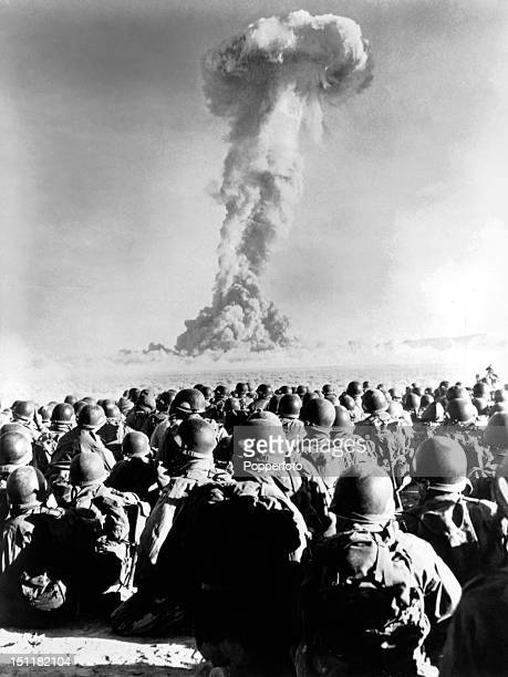 United States troops watch an atomic test at Frenchman's Flat test ground in Nevada USA circa April 1951 This image is from the archives of the...