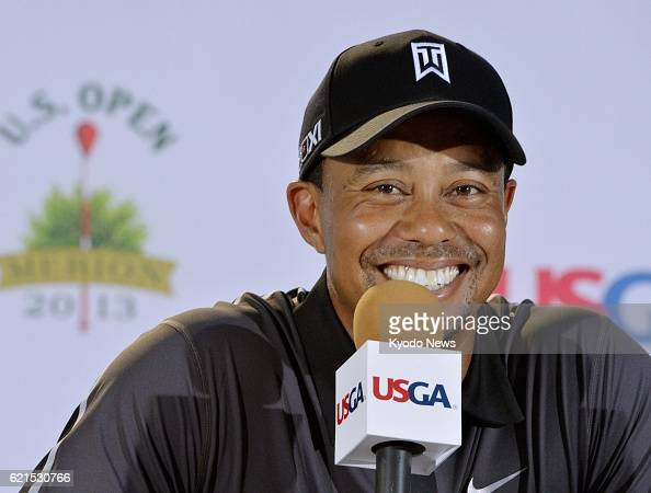 ARDMORE United States US golfer Tiger Woods smiles during a press conference at Merion Golf Club in Ardmore Pennsylvania on June 11 before the start...