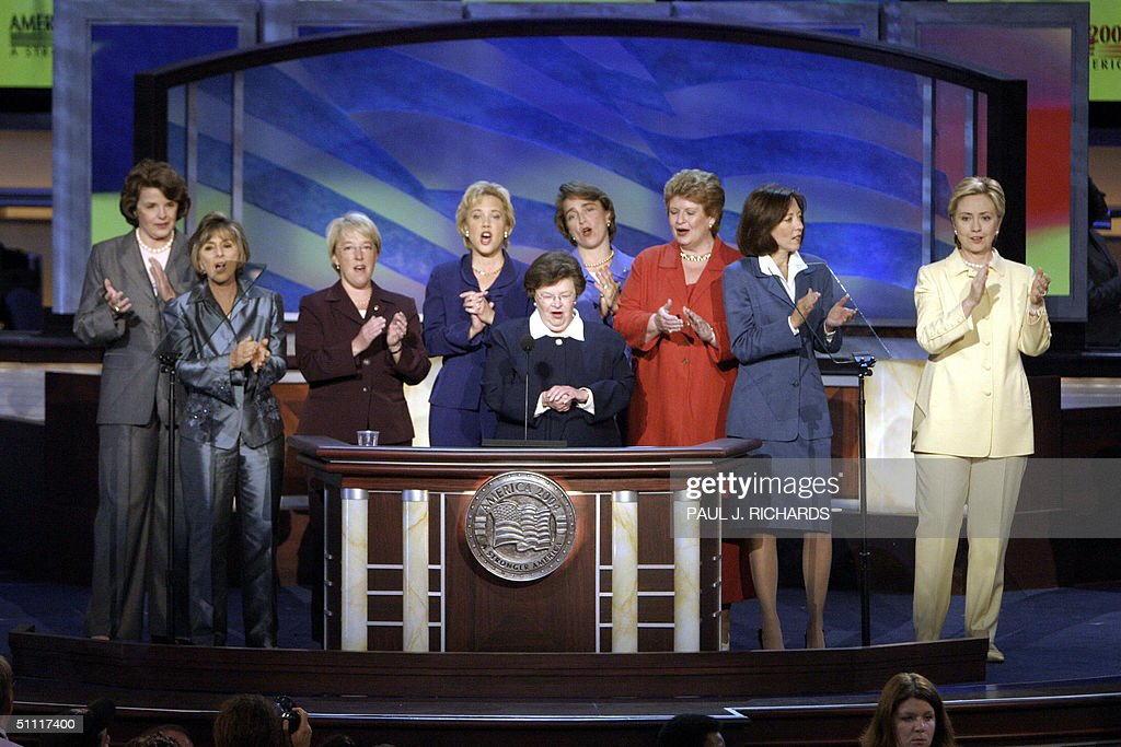 US Senator <a gi-track='captionPersonalityLinkClicked' href=/galleries/search?phrase=Barbara+Mikulski&family=editorial&specificpeople=226768 ng-click='$event.stopPropagation()'>Barbara Mikulski</a> (at podium) applauds along with the other women Democratic senators of Congress at the Democratic National Convention 26 July, 2004, at the FleetCenter in Boston, Massachusetts. US Democrats opened their four-day national convention in which delegates will formally nominate Senator John Kerry to challenge US President George W. Bush for the White House in the 02 November vote.