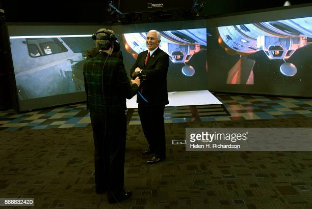 LITTLETON CO OCTOBER 26 United States Vice President Mike Pence middle gets a laugh as he watches Heather Wilson Secretary of the Air Force use VR...