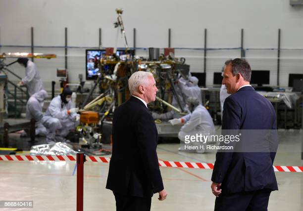 LITTLETON CO OCTOBER 26 United States Vice President Mike Pence middle looks at InSight NASA's next Mars Lander in background with Dr Thomas...