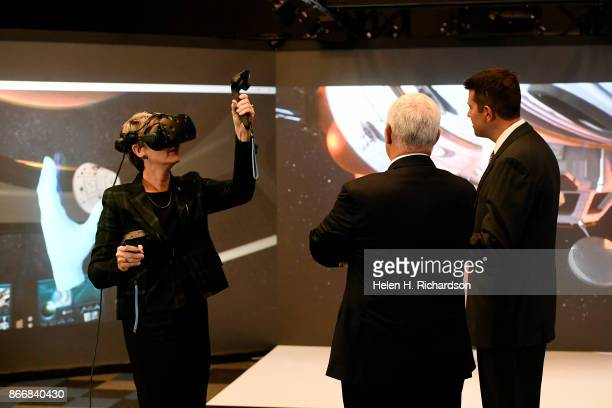 LITTLETON CO OCTOBER 26 United States Vice President Mike Pence middle watches Heather Wilson Secretary of the Air Force left use VR glasses inside...