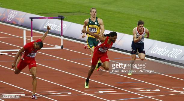 United States's Aries Merritt dips on the line to win the men's 110metre hurdles final on day 12 of the Olympic Games in London