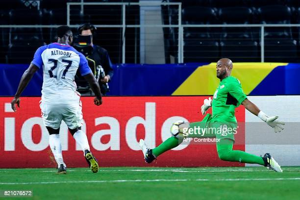 United States's forward Jozy Altidore scores agains Costa Rica's goalkeeper Patrick Pemberton during second half of the Costa Rica vs United States...