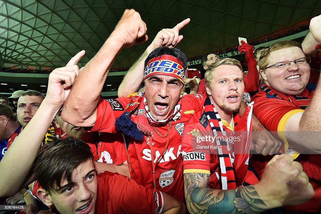 United supporters show their support after the 2015/16 A-League Grand Final match between Adelaide United and the Western Sydney Wanderers at Adelaide Oval on May 1, 2016 in Adelaide, Australia.