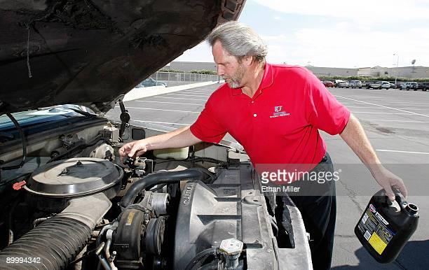 United Suzuki Mitsubishi service manager Kevin Blackwell uses a sodium silicate solution to kill the engine of a 1993 Chevrolet Silverado 1500 pickup...