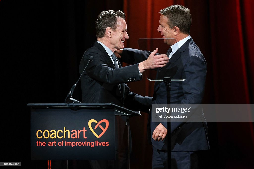 United Talent Agency CEO Jeremy Zimmer (R) and actor <a gi-track='captionPersonalityLinkClicked' href=/galleries/search?phrase=Bryan+Cranston&family=editorial&specificpeople=217768 ng-click='$event.stopPropagation()'>Bryan Cranston</a> onstage during CoachArt's 9th Annual 'Gala Of Champions' at The Beverly Hilton Hotel on October 17, 2013 in Beverly Hills, California.