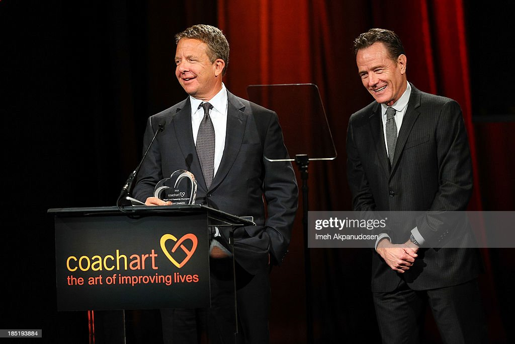 United Talent Agency CEO Jeremy Zimmer (L) and actor <a gi-track='captionPersonalityLinkClicked' href=/galleries/search?phrase=Bryan+Cranston&family=editorial&specificpeople=217768 ng-click='$event.stopPropagation()'>Bryan Cranston</a> speak onstage during CoachArt's 9th Annual 'Gala Of Champions' at The Beverly Hilton Hotel on October 17, 2013 in Beverly Hills, California.