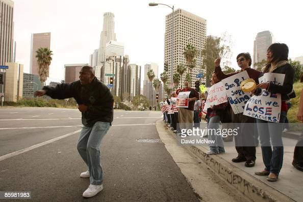 United Teachers Los Angeles union organizer Mike Gipson leads teachers and supporters in a chant as the Los Angeles Unified School District Board of...