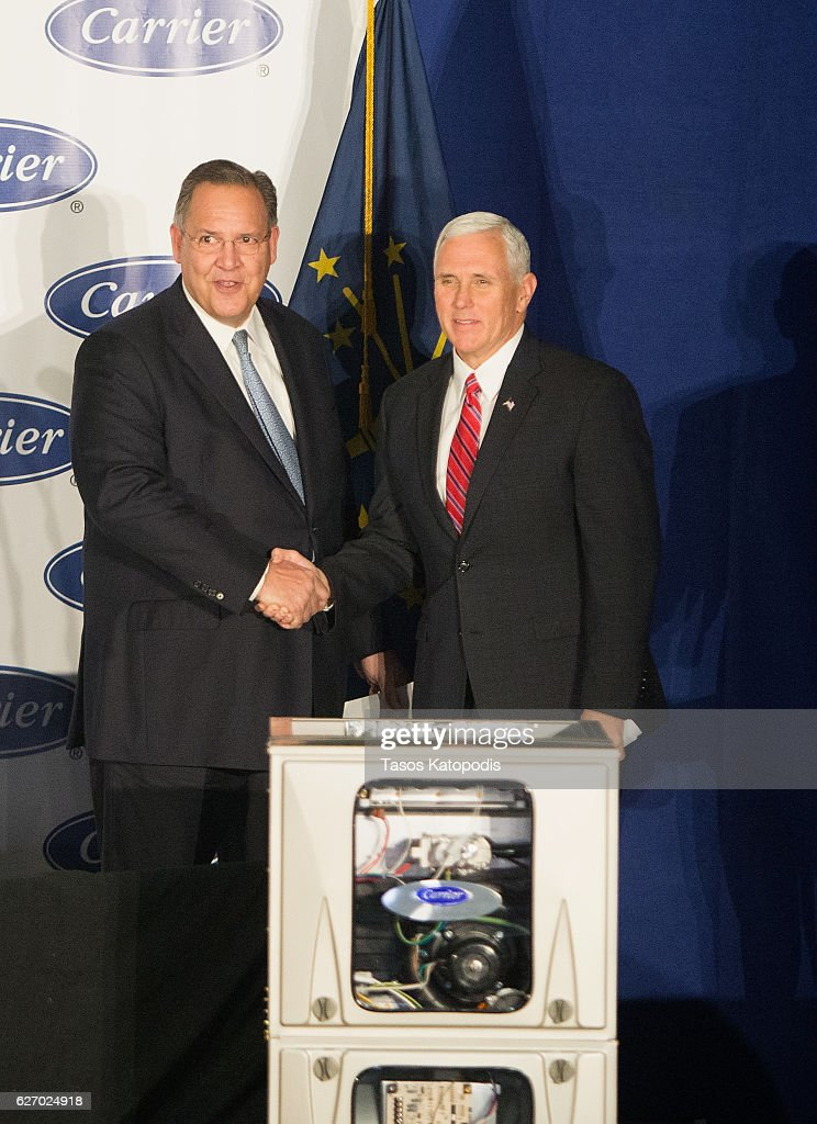 United Technologies CEO Gregory Hayes and Vice President-elect Governor Mike Pence visit the Carrier air conditioning and heating company greets workers on December 1, 2016 in Indianapolis, Indiana.