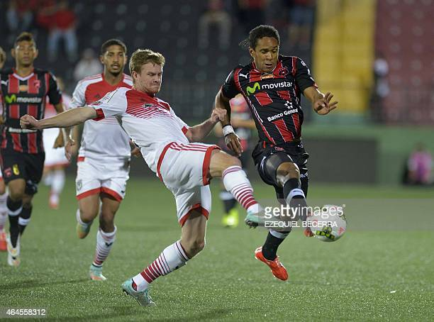 DC United's Bobby Boswell and Jonathan Mac of Liga Deportiva Alajuelense vie for the ball during the Concacaf Champions League quarterfinal match in...