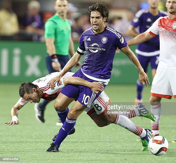 DC United's Davy Arnaud pulls down Orlando City's Kaka at the Orlando Citrus Bowl on Friday April 3 2015 DC United won 10